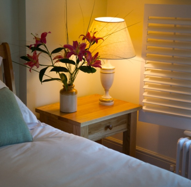 Rooms bed and bedside table